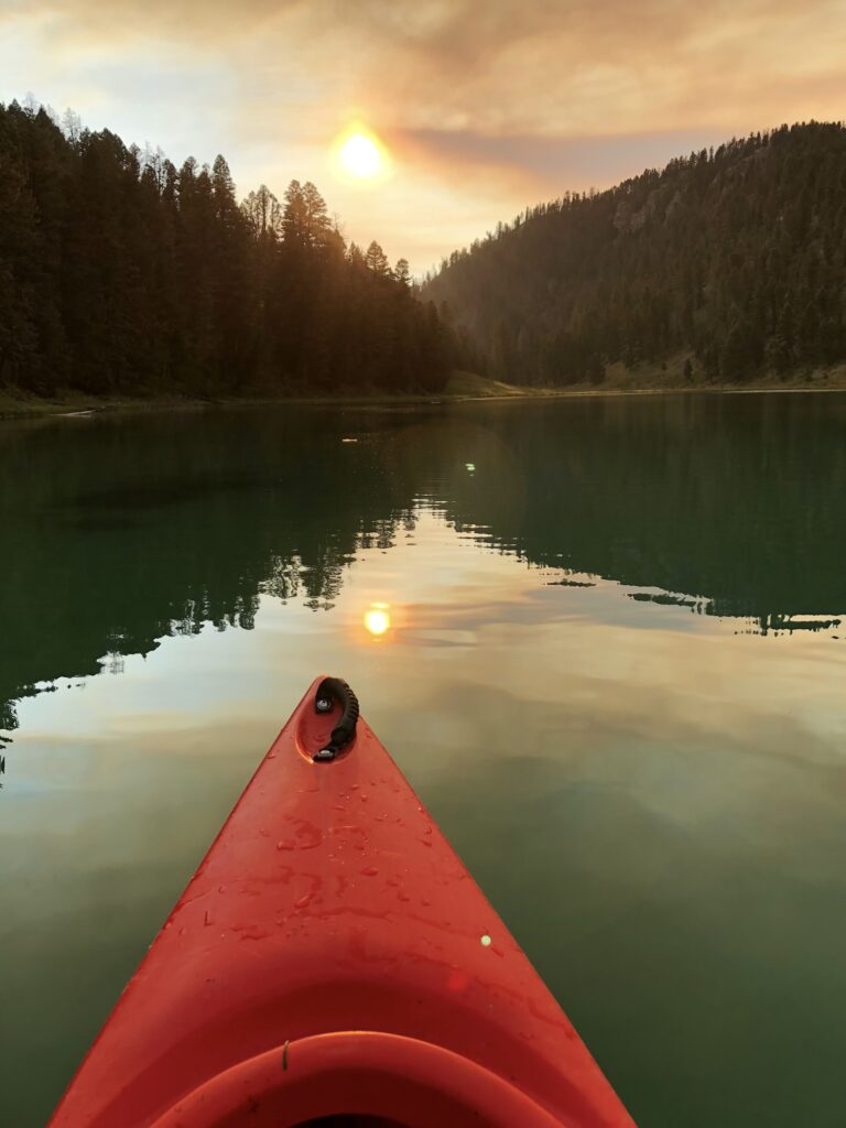 My Kind of Livable:Enjoying the silence and serenity of sunset paddles on still water.